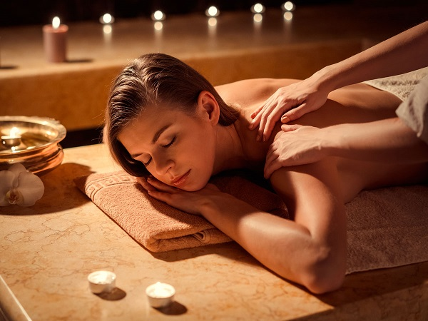 A Beautiful Image of a woman experiencing massage therapy.